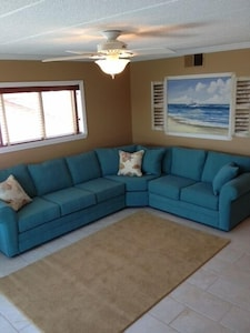 Recently remodeled with new sectional and wall mural.