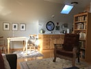Dining and kitchen area.  Open floor plan.  Bright and sunny.  Original artwork.