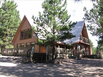 Our chalet retreat, nestled among the trees, on two acres of paradise.