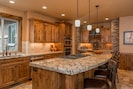 Gourmet kitchen with large island and 6 bar stools for additional seating.