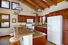 Kitchen and Dining areas are spacious and modern with granite countertops