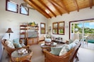 Spacious living room with vaulted cedar ceiling and comfortable seating for six