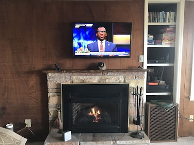 Gas fireplace with TV above.