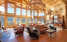 Great Room with views of bar and chandelier.