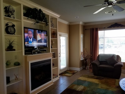 Enjoy your view from the living room or patio, or watch TV/DVD!