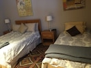 second bedroom with queen and twin beds