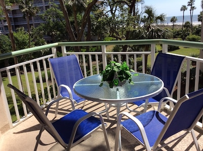 Balcony with 4 chairs and table.  1 chaise  lounge