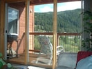 View out back deck to slopes
