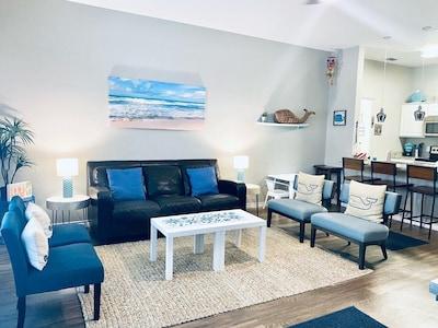 Living room has plenty of seating