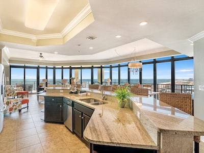 Kitchen/Family/Dining with View of Balcony & Beach