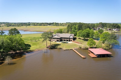 House and boathouse, aerial lake view.