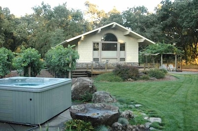 Acorn House features its own hot tub, deck, and patio.