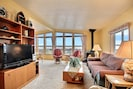 Water views from comfortable living room.  Entertainment Center w/flat screen TV