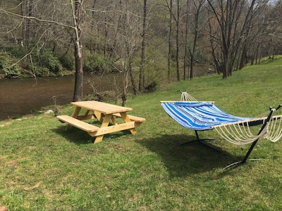 double hammock to relax by the river, tubes provided, camp fire