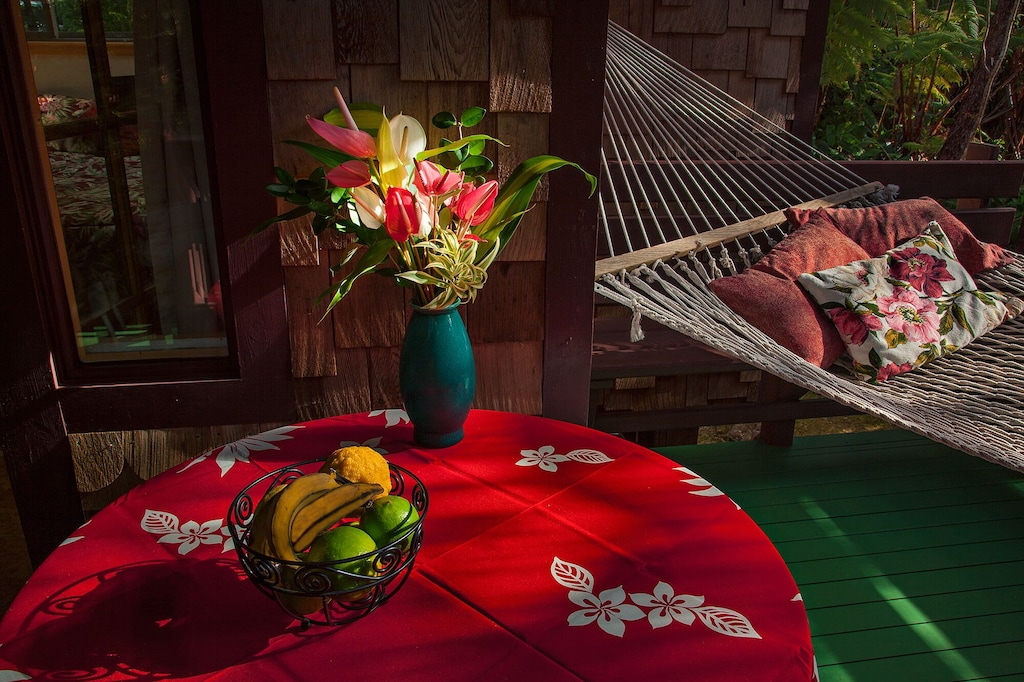 Red table cloth and hammock at the lanai of this Airbnb on Big Island Hawaii