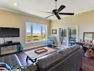 Family room with sliding glass doors leading to screened lanai