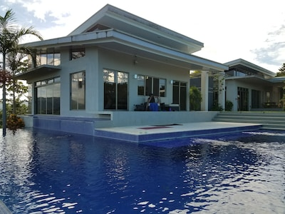 "Pool is ""L shaped"", surrounding the master living room"