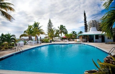 The pool is adjacent to your beach!