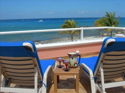 Relaxing with margaritas on the terrace, watching the dive boats drift by.