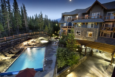 The view from your deck of the year round heated pool & hot tubs.