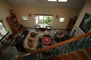 View of living room from upstairs hall