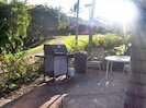 BBQ in tropical setting with scenic views only a few steps from condo.