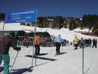Skiwatch condo in background with Colorado and Rocky Mountain Super chairs.