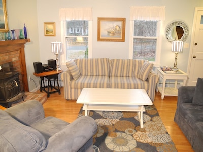 Bright, comfortable living room with flatscreen TV
