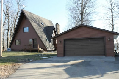 Road-facing view of the cabin. Large driveway, plenty of room for parking.