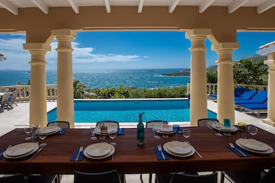 Covered outdoor dining table that sits 8 very comfortably.Breakfast with a view!
