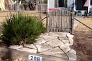 Front Gate at street. Paved walk to cozy front porch -great place to enjoy your morning coffee.