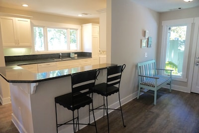 renovated kitchen with large picture window overlooking golf course