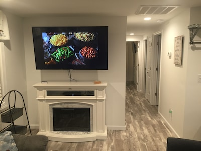 """60"""" tv in living room with HD cable"""