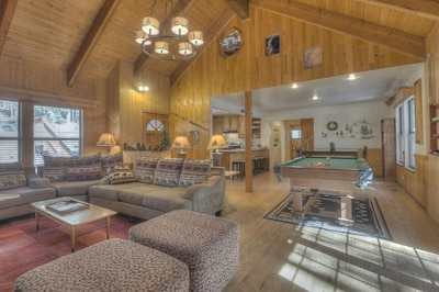 Large open Great Room with pool table, TV stone fireplace, knotty pine decor