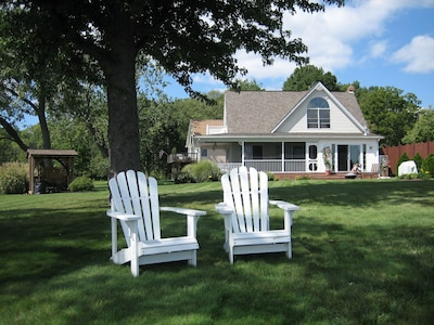 Imagine the days lounging on these Adirondack chairs
