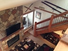 Brand new fireplace with mounted flat screen, stairs leading to loft