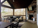 Beautiful screened in porch with lake view - just off kitchen / dining area