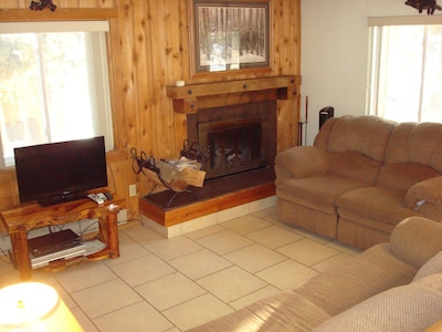 Get cozy in the living room with a wood burning fireplace.