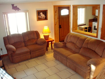 The comfortable living room is perfect for relaxing after a day of adventure.