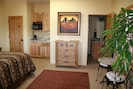 Cathedral Suite with kitchenette & bistro table and chairs