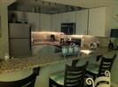 New under mount lighting in Kitchen ,  new glass block back splash;) Unit 1603