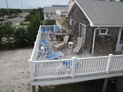 Spacious deck for dining and/or sunbathing.