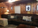 Living room - sectional couch - very comfortable. Seats 6-7 people. Shoe caddy.