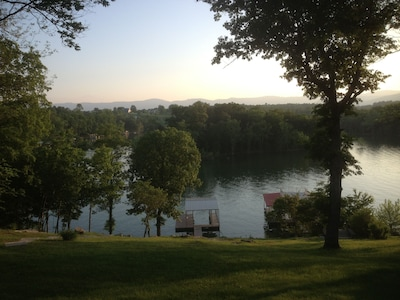 Picturesque view of lake with mountains from our deck!