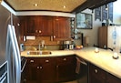 Handmade kitchen cabinetry and bamboo add to island feel.