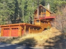 Chalet style home with 2 car garage and enclosed walkway.