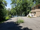 Wrap around driveway that leads to boat ramp and plenty of parking