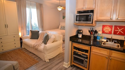 Condo features a plush queen bed and full size sleeper sofa