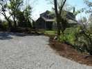 Crushed stone driveway is private and a beautifully landscaped NE garden.