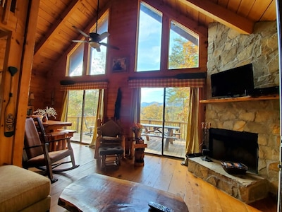 3 story log home overlooking Mirror Lake and Beach. Steps in back yard to lake.